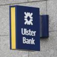 ulster bank cuts losses by nearly 50%